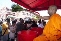 Blessing. KUALA LUMPUR, MALAYSIA, May 17, 2011 : Monk giving blessing during Wesak days celebration at Buddhist Maha Vihara Temple, Kuala Lumpur Malaysia Stock Photo