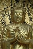 Blessing Buddha. Bronze icon blessing Buddha in serene mood Royalty Free Stock Photography