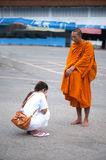 Blessing from Buddhist monk. Stock Photo