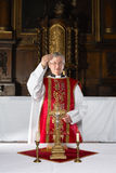Blessing during catholic mass stock photo