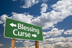 Blessing, Curse Green Road Sign and Clouds Royalty Free Stock Photos