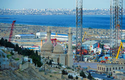 Blessing the fleet. The Bibi Heybat mosque provides a daily blessing looking over the fleet in the Baku shipyard. A steady stream of worshippers pray for safety Royalty Free Stock Photo