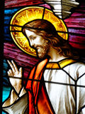 Blessing in Glass. Stained glass of Christian Jesus giving blessing or benediction with the special finger configuration of the right hand Stock Images