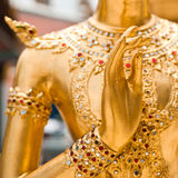 Blessing hand of Golden Kinnari statue. Thailand Royalty Free Stock Photo