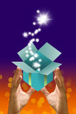 Blessing star flying out from gift box in the hand Royalty Free Stock Photography