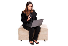 Blessing to work. An isolated businesswoman on white background sat using a laptop Stock Images