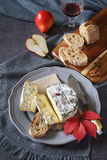 Bleu cendre, french mould cow`s milk cheese, bread and red pears. On dark background. Top view Stock Photo
