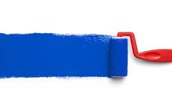 Bleu de rouleau de peinture Photos stock
