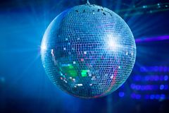 Bleu mirror ball rolling in the night club Royalty Free Stock Photos