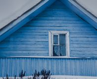 Bleu rustic house in country in winter stock photography