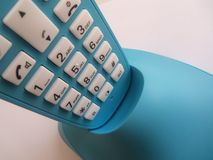 Bleu telephone in charger Stock Image