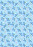 Bleuets bleu-foncé sur un fond sans couture bleu-clair Images stock