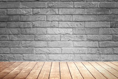 Blick brown wall background and wood shelf. Royalty Free Stock Photography