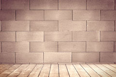 Blick brown wall background and wood shelf. Stock Images
