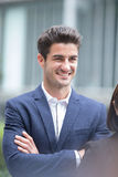 Blick för leende för affärsman något Arkivfoto