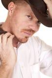 Blicklächeln der Cowboyhut-Weste in der Hand Stockfotografie