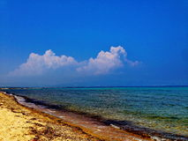Blie sea and clouds. A picture of blue sea in a summer beach, and white clouds in the sky,in an area in Greece,Halkidiki,in a summer day Stock Photos