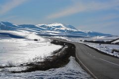 Blig snow and glare mountains. The road to the snow mountain. stock photo