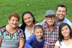Blij echt etnisch familieportret stock afbeeldingen