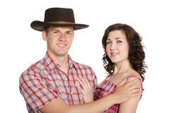 Blij meisje en een kerel in een cowboyhoed Royalty-vrije Stock Afbeeldingen