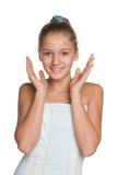 Blij preteen meisje tegen het wit Royalty-vrije Stock Afbeelding