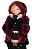 Blije blonde vrouw in bontjasje Stock Foto