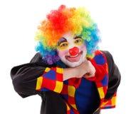 Blije clownsteun in lucht Stock Afbeeldingen