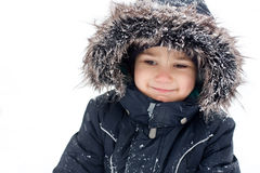 Blije jongen in snowsuit Royalty-vrije Stock Foto's