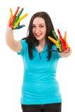 Blije vrouw met kleurrijke handen stock afbeelding