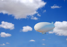 Blimp. A white blimp flying in a clear blue sky with puffy white clouds stock photo