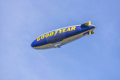 Blimp with Good Year logotype. FORT LAUDERDALE, USA - AUG 1, 2010: The Good Year blimp Zeppelin, Spirit of Goodyear (with distinctive yellow stripe), flies over royalty free stock images