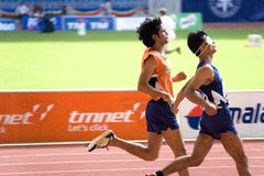 Blind Athlete. Image of a blind athlete (assisted by his guide) competing in the men's 100 meters sprint event at the 9th Fespic Games held in Kuala Lumpur royalty free stock image