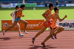 Blind Athletes. Image of blind athletes (assisted by guides) competing in the men's 100 meters sprint event at the 9th Fespic Games held in Kuala Lumpur stock photos