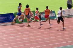 Blind Athletes. Image of blind athletes (assisted by guides) competing in the men's 100 meters sprint event at the 9th Fespic Games held in Kuala Lumpur royalty free stock photos