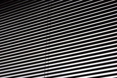 Blind background. Abstract image of mini blinds open in window forming dark and light lines. suitable as background image or wallpaper Stock Image