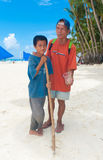 Blind beggar. BORACAY ISLAND, PHILIPPINES - SEPTEMBER 05: Blind man with his son begging for money on September 05, 2011 on Boracay , Philippines. With no social Royalty Free Stock Image