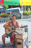 Blind Beggar. Singing with guitar along Session Road, Baguio City, Philippines Royalty Free Stock Images