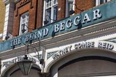 The Blind Beggar Pub in London. The exterior of The Blind Beggar public house on Whitechapel Road in London, UK.  The pub is known to be the location of the Stock Images