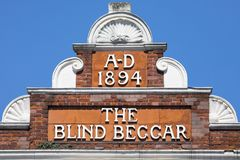 The Blind Beggar Pub in London. LONDON, UK - APRIL 19TH 2018: The original lettering on the exterior of The Blind Beggar public house on Whitechapel Road in Royalty Free Stock Images