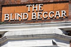 The Blind Beggar Pub in London. LONDON, UK - APRIL 19TH 2018: The original lettering on the exterior of The Blind Beggar public house on Whitechapel Road in Stock Images