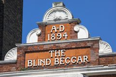 The Blind Beggar Pub in London. LONDON, UK - APRIL 19TH 2018: The original lettering on the exterior of The Blind Beggar public house on Whitechapel Road in Royalty Free Stock Photo