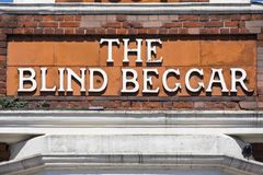 The Blind Beggar Pub in London. LONDON, UK - APRIL 19TH 2018: The original lettering on the exterior of The Blind Beggar public house on Whitechapel Road in Stock Image