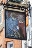 The Blind Beggar Pub in London. LONDON, UK - APRIL 19TH 2018: The sign of The Blind Beggar public house on Whitechapel Road in London, on 19th April 2018.  The Royalty Free Stock Photography