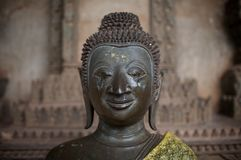 Blind Buddha. Eyes scratched out of a Buddha statue in Laos Stock Image