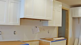 Blind cabinet, island drawers and counter cabinets installed stock footage