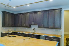 Blind cabinet, island drawers and counter cabinets installed. Kitchen cabinets installation Blind corner cabinet, island drawers and counter cabinets installed royalty free stock image