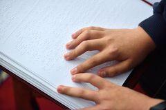 Blind child read book written in Braille Royalty Free Stock Images
