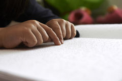 Blind children read text in braille Stock Photos