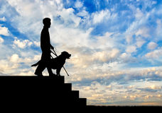 Blind disabled with dog guide goes down day Royalty Free Stock Images