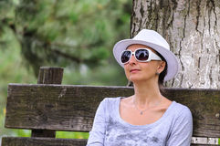 Blind disabled woman resting in park Royalty Free Stock Image